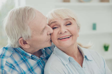Close-up portrait of her she his he two nice attractive lovely affectionate sweet gentle cheerful cheery life partners soulmates cuddling kissing in light white interior house Stock Photo