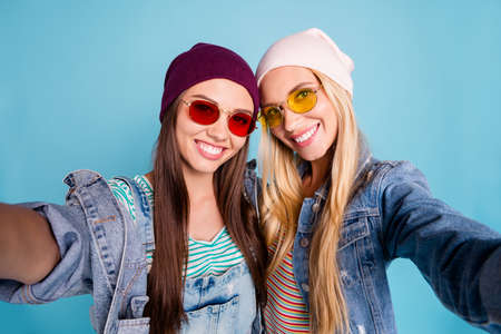 Self-portrait of nice-looking attractive lovely sweet fascinating cheerful cheery girls spending free time having fun isolated over bright vivid shine blue green turquoise background Stock Photo