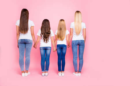 Behind view photo of four ladies ignoring bad guys wear casual outfit isolated pink background