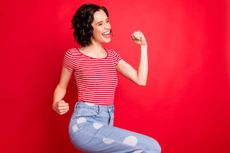 Portrait of her she nice attractive lovely charming cute pretty cheerful cheery wavy-haired girl having fun isolated over bright vivid shine red background Stock Photo