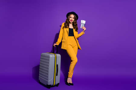 Full length body size view of her she nice chic attractive elegant content cheerful cheery wavy-haired lady boarding time journey posing isolated on bright vivid shine violet lilac background