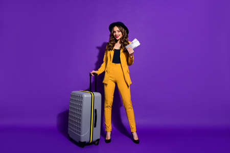 Full length body size view of her she nice chic gorgeous attractive lovely cheerful cheery wavy-haired lady waiting boarding time journey isolated over bright vivid shine violet lilac background