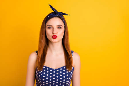 Photo of beautiful foxy lady red lipstick send air kiss wear casual dotted tank-top headband isolated vivid yellow background Stok Fotoğraf