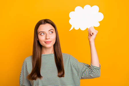 Photo of girl thinking over how to leave yellow background and be transferred to another one while being isolated Foto de archivo