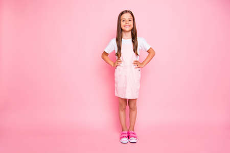Full body photo of little lady brown hair holidays leisure time hands sides wear rose sun dress t-shirt isolated pink background