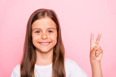 Closeup photo of small lady brown hair v-sign symbol hand say hi hello friends wear overall t-shirt isolated pink background