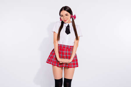 Portrait of her she nice-looking attractive winsome lovely charming cute cheerful modest girl wearing checkered skirt isolated over light white background