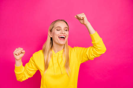 Photo of pretty yelling lady raising hands air wear yellow hoodie pullover isolated pink background