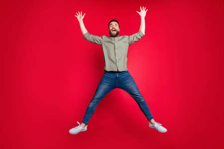 Full length body photo of falling man showing you shape of star while isolated with red background