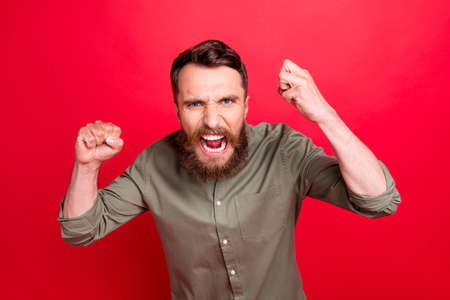 Photo of raging evil irritated man ready for fight and battle while isolated with red background 版權商用圖片