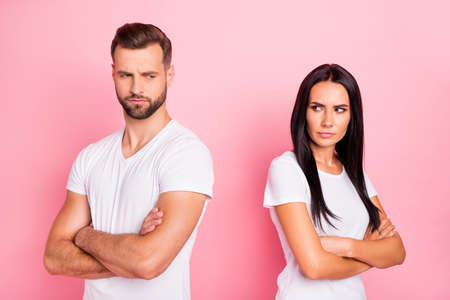 Portrait of his he her she two nice-looking attractive lovely charming sullen moody spouses folded arms difficulties with understanding isolated over pink pastel background