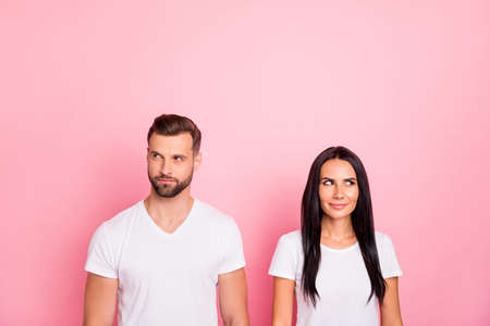 Portrait of his he her she two nice-looking attractive lovely charming cute winsome cheerful person looking aside thinking isolated over pink pastel background Stock Photo