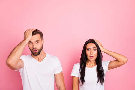 Portrait of his he her she two nice-looking attractive lovely disappointed sullen dissatisfied confused person isolated over pink pastel background
