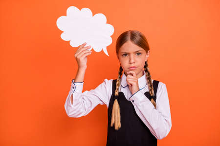 Close-up portrait of her she nice attractive suspicious pre-teen blonde girl holding in hand copy empty blank space card dilemma choose choice isolated on bright vivid shine orange background
