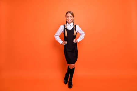 Full length body size view of her she nice attractive lovely cheerful cheery content pre-teen girl enjoying going first grade 1 September isolated on bright vivid shine orange background