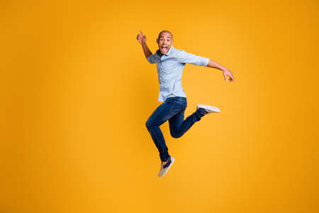 Full body photo of funky man feel content careless isolated over yellow background