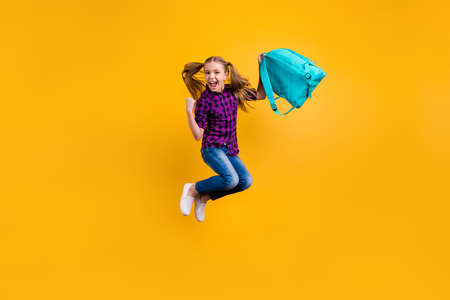 Full length photo of small pupil jump high finally holidays hooray wear casual checkered shirt jeans denim isolated yellow background Stok Fotoğraf