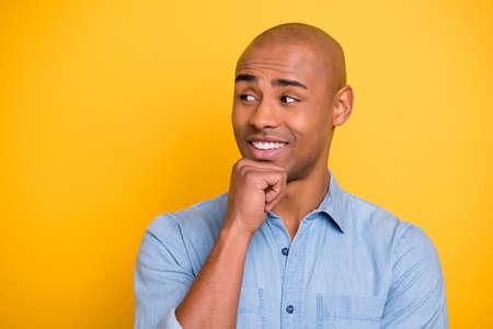 Photo of dark skin macho positive listen wondered partners corporate meeting wear jeans denim shirt isolated bright yellow background