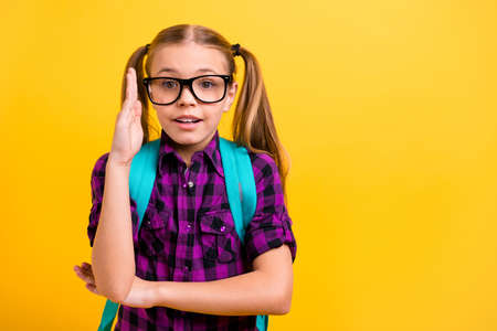 Close up photo of small lady pupil raise arm air lesson know answer wear specs casual checkered shirt isolated yellow background