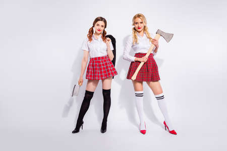 Full body photo of two scary ladies ready for helloween party wear costumes isolated white background