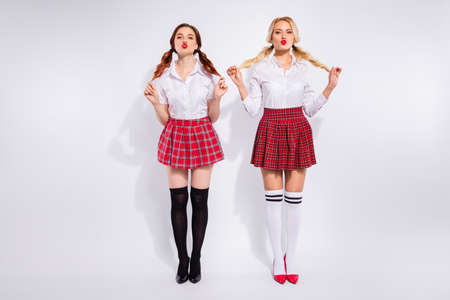 Full body photo of two ladies sending air kiss guys wear plaid skirts tights isolated white background