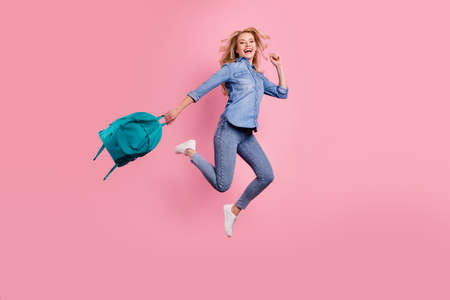 Full body photo of crazy lady glad classes end jumping high wear denim outfit isolated pink background