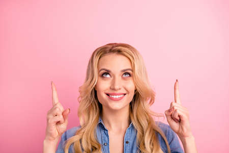 Close-up portrait of her she nice-looking attractive lovely winsome shine cheerful cheery glad wavy-haired girl pointing two forefingers up good cool ad advert isolated over pink pastel background