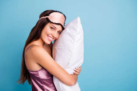 Profile side view portrait of her she nice-looking attractive lovely pretty feminine cheerful cheery girl embracing pillow late time isolated on bright vivid shine teal blue green turquoise background Imagens