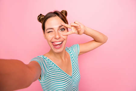 Self-portrait of her she nice-looking lovely charming cute cheerful cheery positive girl showing v-sign near eye having fun fooling isolated over pink pastel background