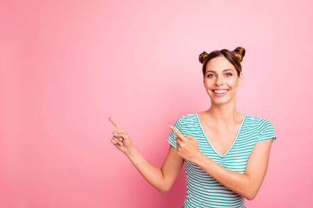 Portrait of her she nice-looking lovely pretty charming cute cheerful cheery content girl showing copy empty blank space place ad isolated over pink pastel background Stockfoto