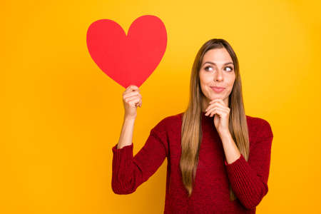 Closeup photo of pretty lady holding big red paper heart wear burgundy pullover isolated bright yellow background