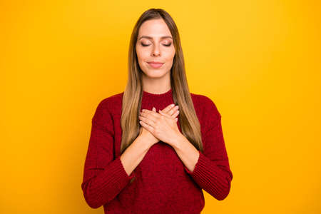 Closeup photo of pretty lady holding hands on chest wear burgundy pullover isolated bright yellow background