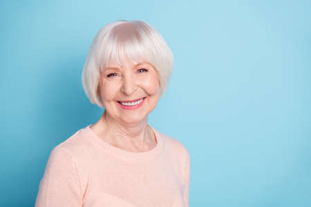 Close-up portrait of  nice-looking attractive lovely kind healthy well-groomed cheerful cheery glad gray-haired lady enjoying spring isolated over bright vivid shine blue green teal background Stok Fotoğraf