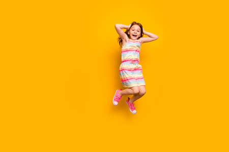 Full length photo of cute astonished child touching her head screaming shouting isolated over yellow background 写真素材