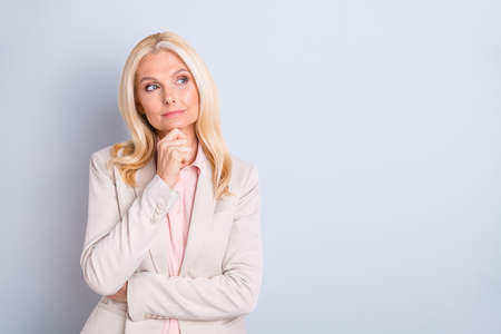 Portrait of her she nice attractive charming stylish minded focused wavy-haired lady executive director creating new plan agenda touching chin isolated over light white gray pastel background Banco de Imagens