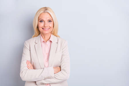Portrait of her she nice-looking attractive lovely chic classy successful content cheerful cheery glad gray-haired businesslady folded arms isolated over light white gray pastel background