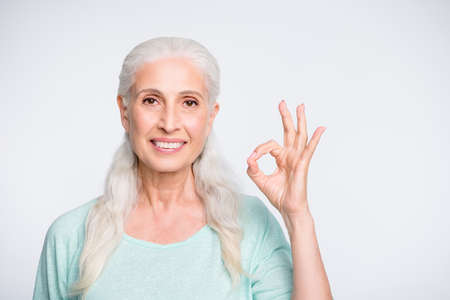 Close up photo of pretty lady making ok sign looking recommending ads wearing teal jumper isolated over white background