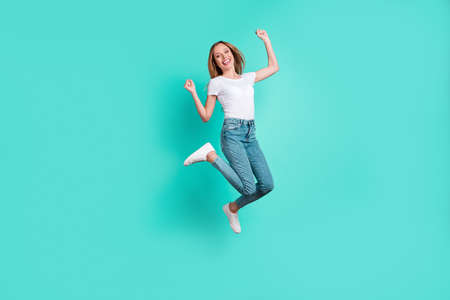 Full body photo of lovely cheerful person raising fists hands screaming shouting yeah isolated over teal turquoise background