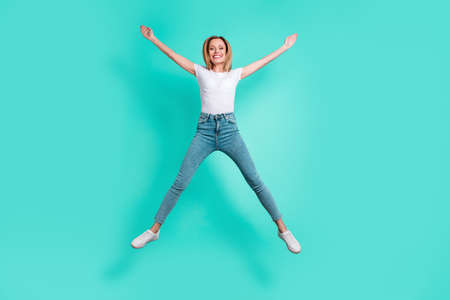 Full size photo of charming youth raising hands isolated over teal turquoise background