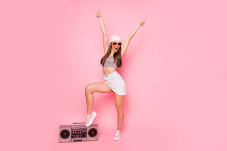 Full length photo of funky youth raising hands screaming wearing eyewear eyeglasses isolated over pink background