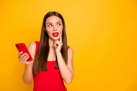 Portrait of her she nice-looking attractive glamorous lovely gorgeous pretty cute posh cheerful foxy bewildered straight-haired lady creating strategy isolated on bright vivid shine yellow background Stock Photo