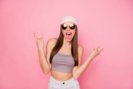 Portrait of childish person teen making horns shouting grimacing wearing eyewear eyeglasses isolated over pink background Stock Photo