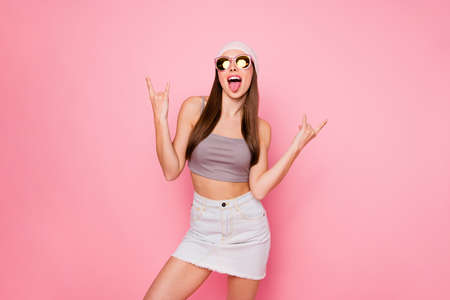 Portrait of funky teen making faces screaming shouting wearing eyeglasses eyewear tank-top isolated over pink background