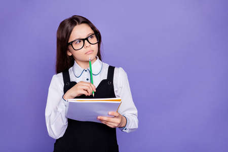 Close-up portrait of her she nice attractive lovely bewildered diligent pre-teen girl nerd solving doing class home work task solution isolated over bright vivid shine violet background Stok Fotoğraf