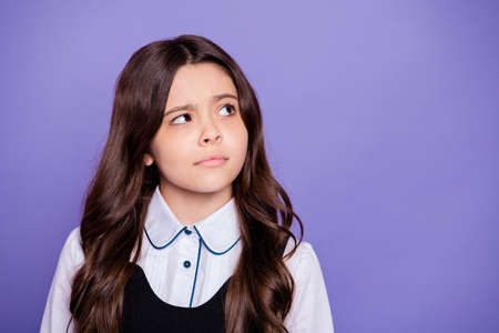 Close-up portrait of her she nice-looking attractive winsome doubtful clever, smart brainy wavy-haired pre-teen girl learning isolated over bright vivid shine violet background