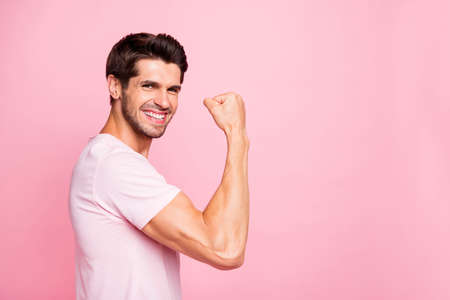 Profile side view portrait of his he nice attractive lovely cheerful cheery glad content guy showing winning gesture isolated over pink pastel background
