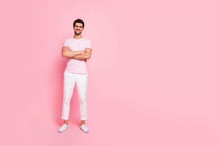 Full length body size view portrait of his he nice attractive handsome lovely virile muscular cheerful cheery content guy folded arms isolated over pink pastel background
