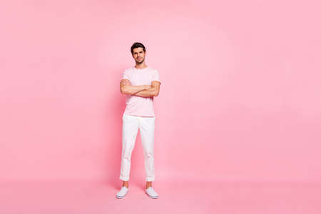 Full length body size view portrait of his he nice attractive lovely virile peaceful content guy standing folded arms isolated over pink pastel background