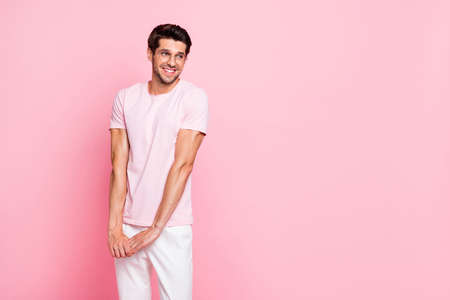 Portrait of his he nice attractive lovely cheerful cheery shy sportive muscular dreamy guy wearing specs posing isolated over pink pastel background