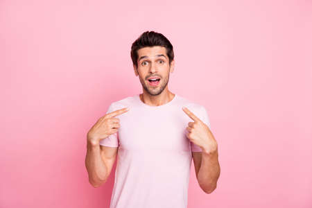 Portrait of his he nice attractive cheerful cheery glad shocked guy presenting surprise gift promotion him self isolated over pink pastel background Stok Fotoğraf
